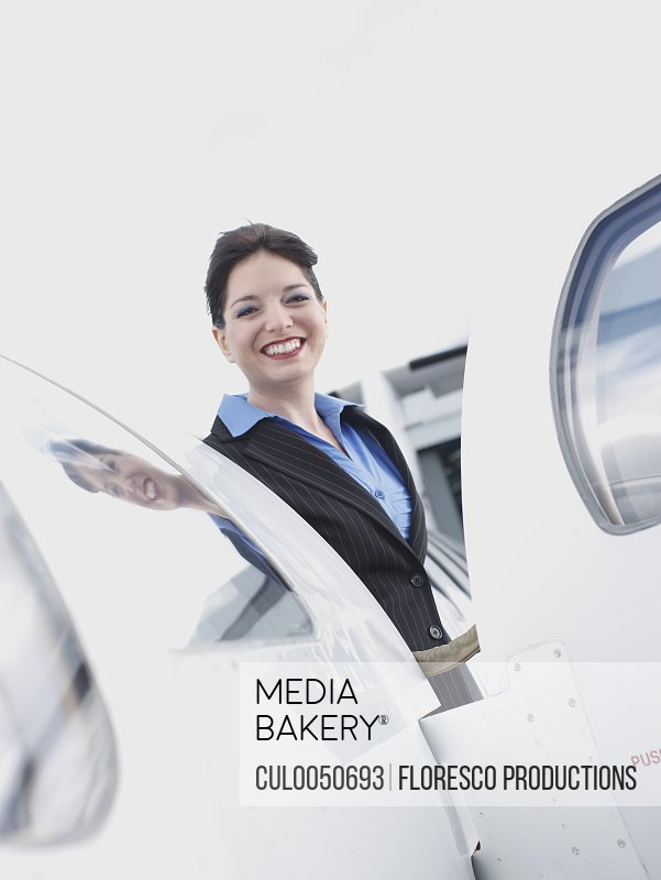 Business woman on corporate jet