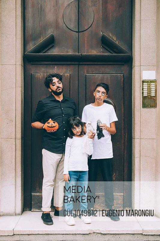 Family in doorway, ready for Halloween