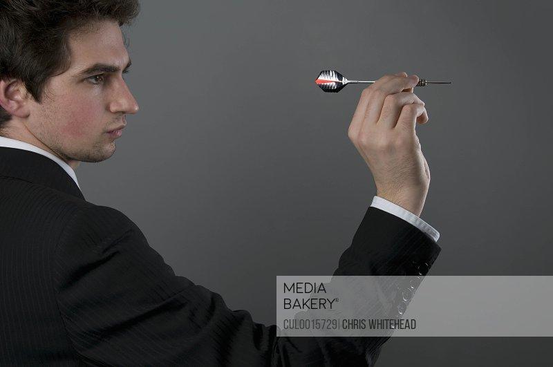 Male holding dart