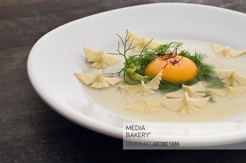 Close up of raw egg and pasta dish