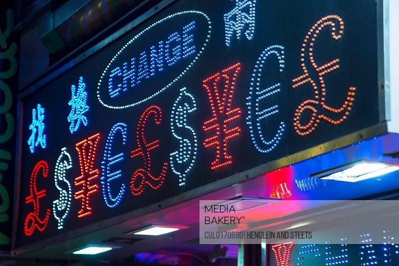 Illuminated currency exchange sign Hong Kong China