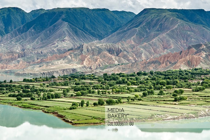 Elevated view of mountains and agricultural land by Yellow river, Sichuan, China