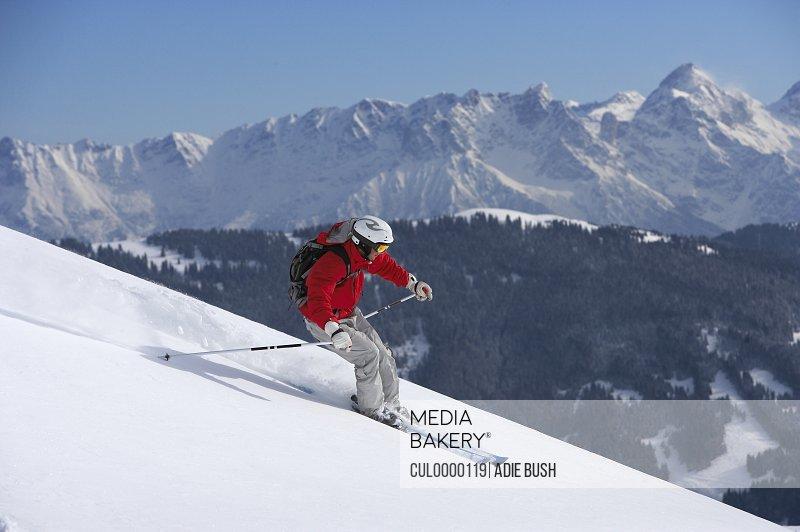man skiing down mountain slope