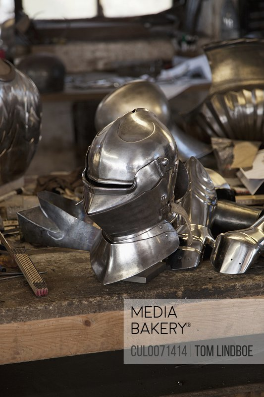 Metal helmet in blacksmith's shop