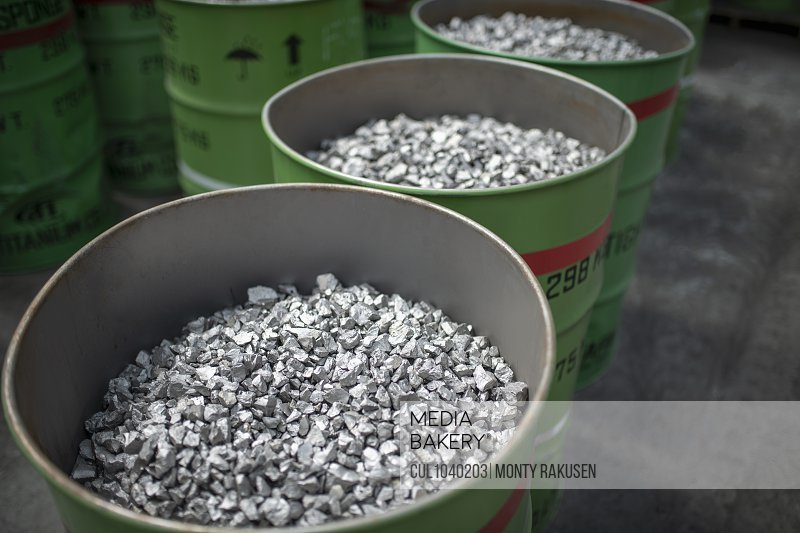 Barrels of crushed titanium in crusher plant in titanium recycling plan