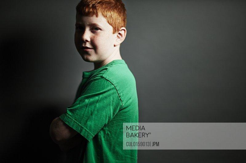 Boy wearing green t shirt