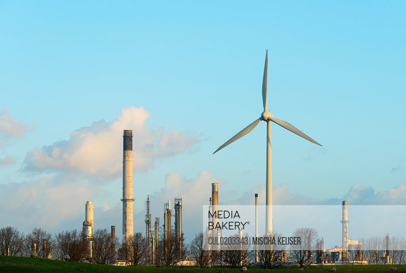 Wind turbine in front of oil refinery Rotterdam Zuid-Holland The Netherlands