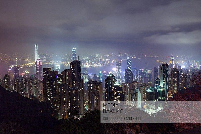 Cityscape of skyscrapers illuminated at night, Hong Kong, China, East Asia