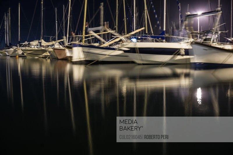 Boats on water at night Cagliari Sardinia Italy