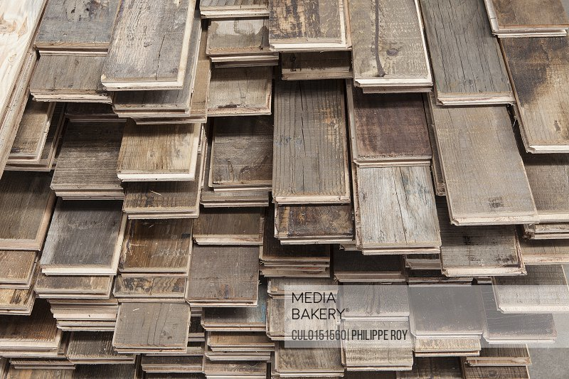 Stacks of treated wood flooring in factory Jiangsu China