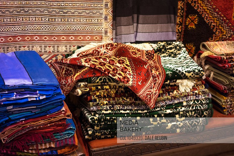 Traditional rugs for sale in Moroccan market