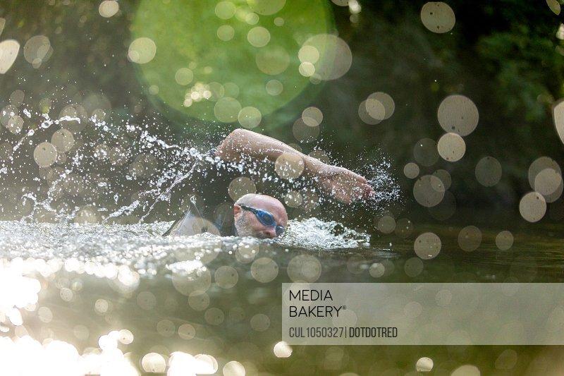 Man swimming in river