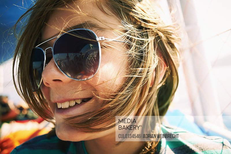 Close up candid portrait of boy in sunglasses