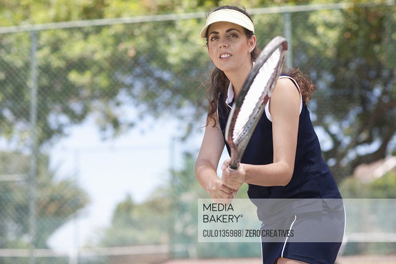 Tennis players returning ball