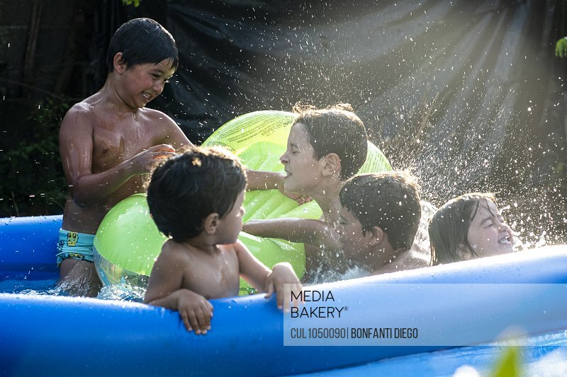 Children playing in a swimming pool