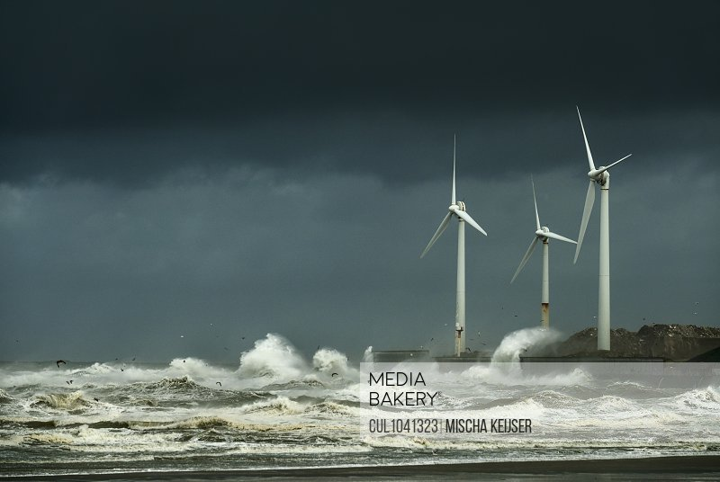Wind turbines battered by large waves on dyke, Boulogne-sur-Mer, Pas-de-Calais, France