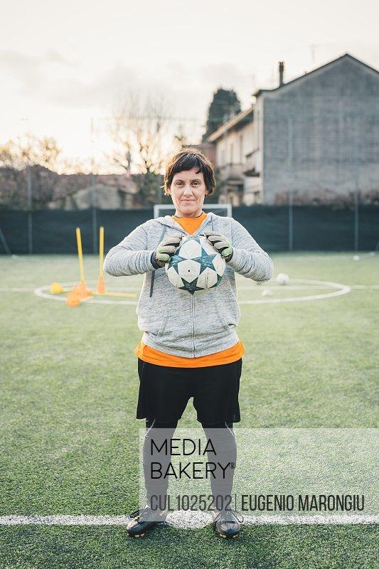 Portrait of female football player