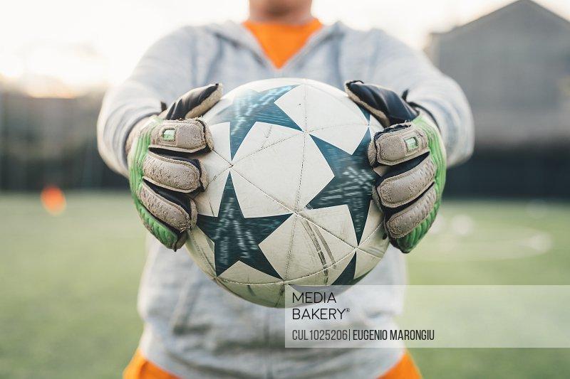 Goalkeeper holding ball