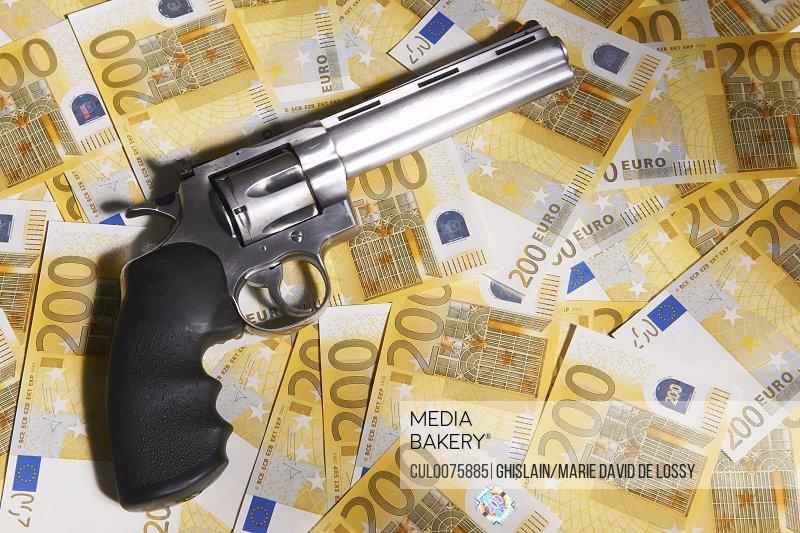Handgun and 200 Euro bills