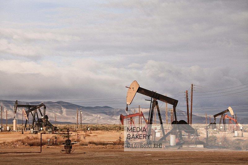 Derricks in oil well California/n