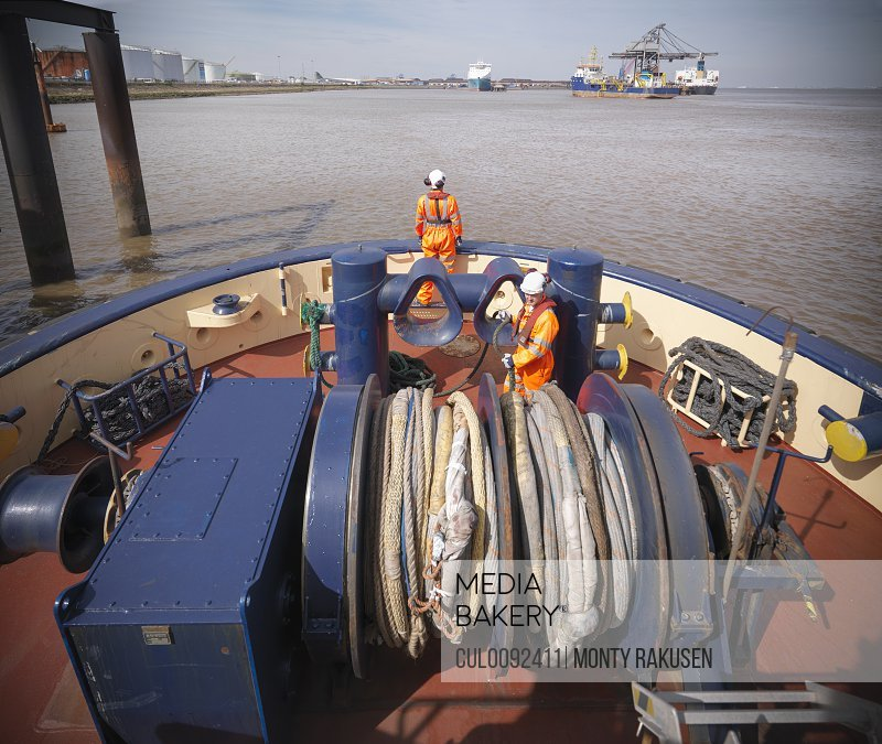 Tugboat worker standing on deck
