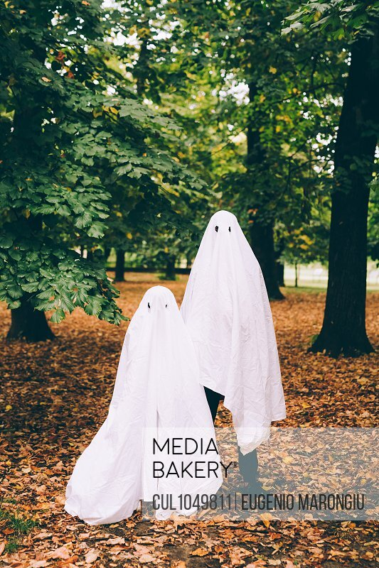 Children in ghost Halloween costumes