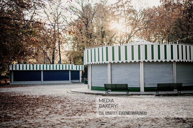 Shuttered kiosks in park during 2020 Covid-19 Lockdown, Milan, Italy