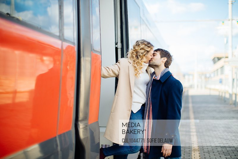 Couple kissing beside train, Firenze, Toscana, Italy