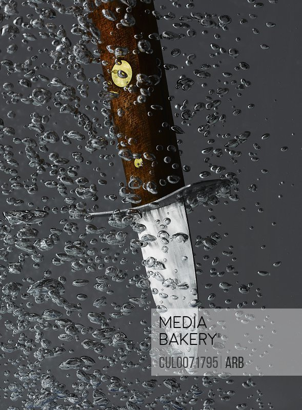 Knife plunging into water
