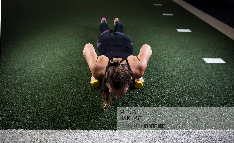 Woman exercising in urban environment