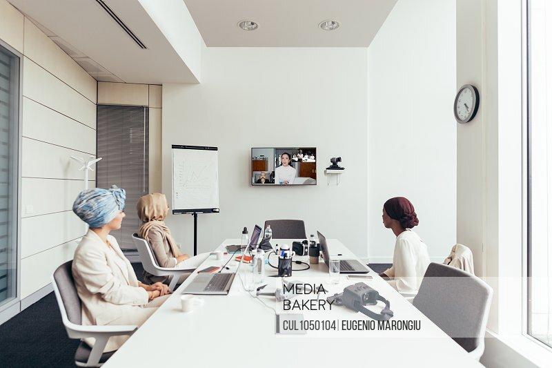 Businesswomen on video call