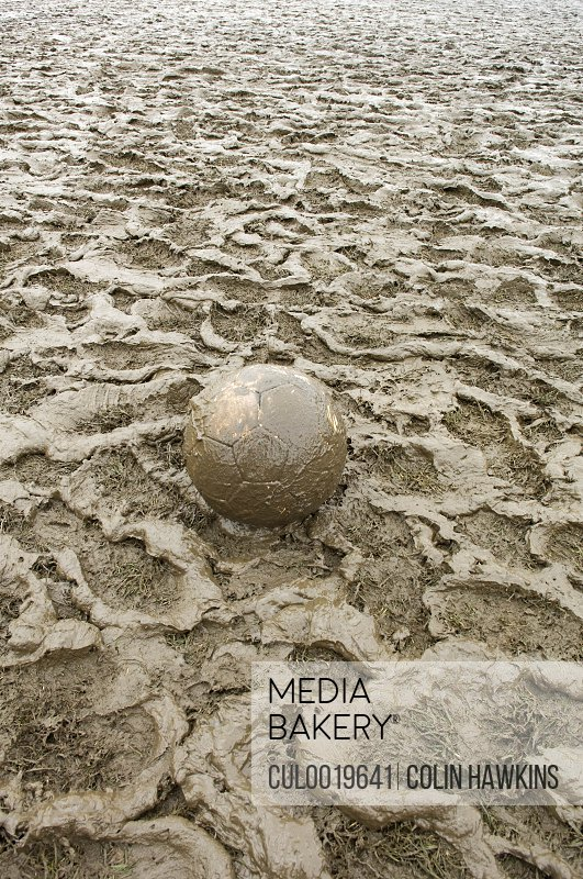 football in muddy field