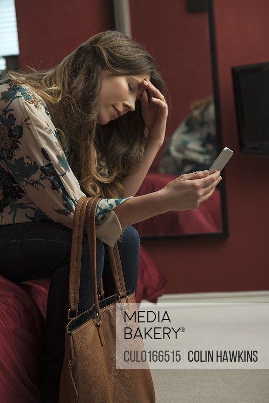 Worried looking woman using phone