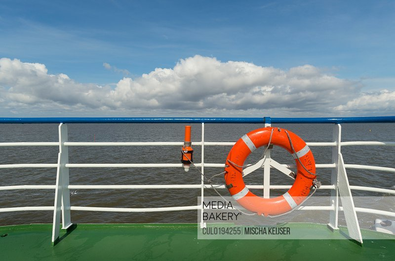 Lifebuoy and radio beacon on ferry Waddenzee Friesland Netherlands