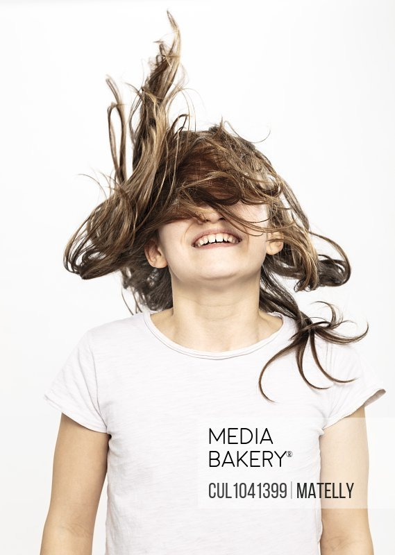 Happy girl with flying hair, white background