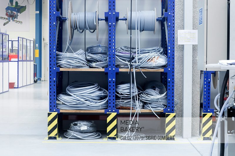 Electrical cables on shelf in engineering plant
