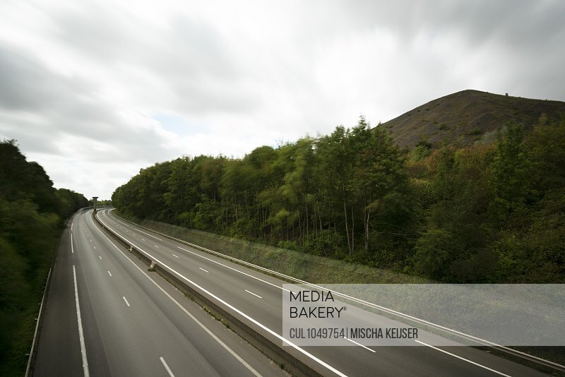 The motorway A21 passes a mountain formed by the former mining industry, Lens, Pas-de-Calais, France