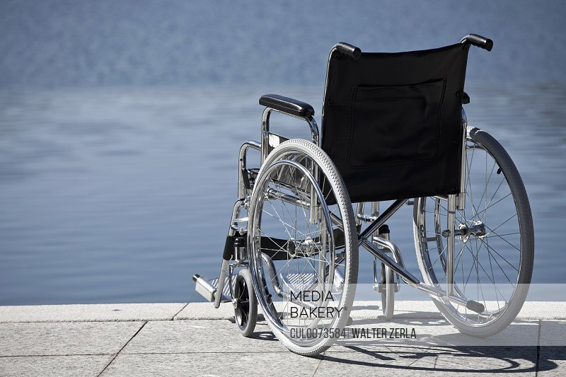 Wheelchair parked by water