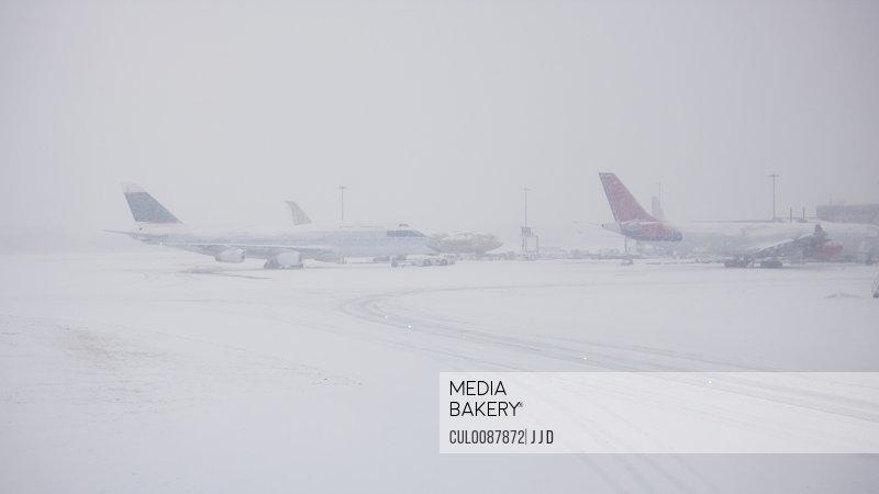 Airplanes on snowy runway