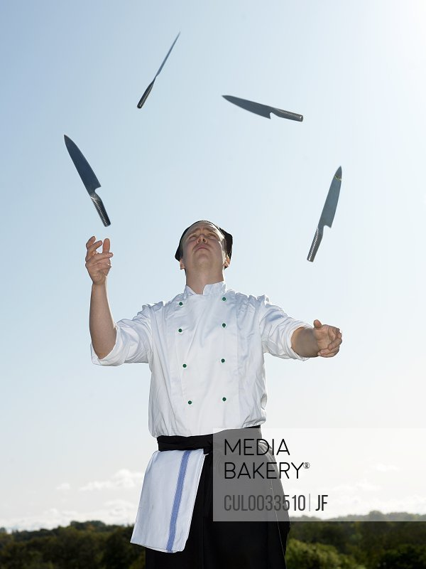 Chef juggling with knives