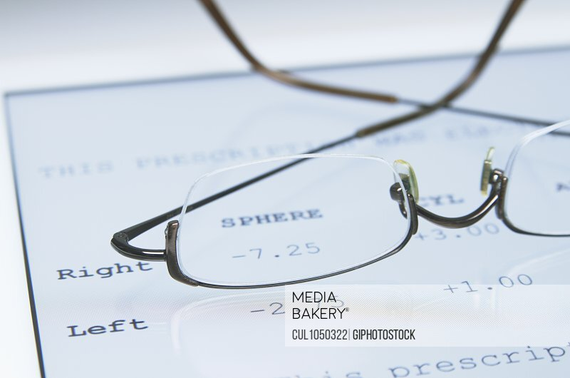 Spectacles for myopia correction on a digital tablet that displays a Property Released (PR)escription for glasses
