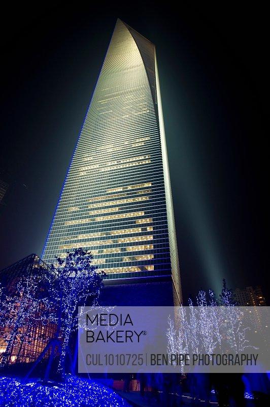 City skyscraper lit up at night