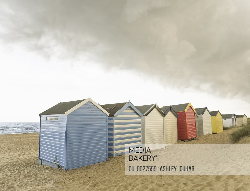 Beach huts under brooding sky