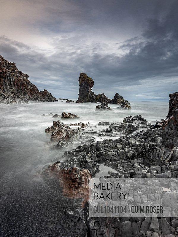 Rock formations in ocean, Vesturland, Iceland