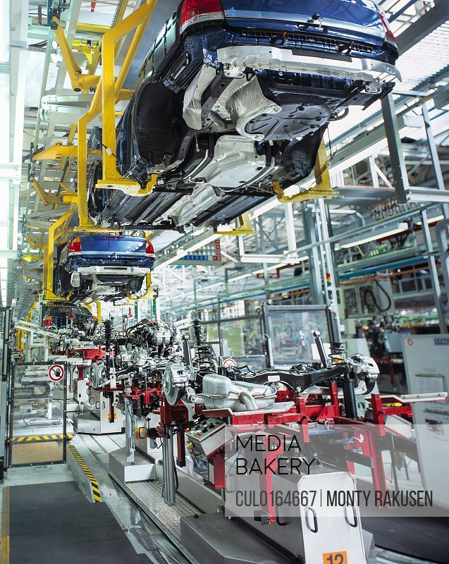 Car bodies and engines in car factory