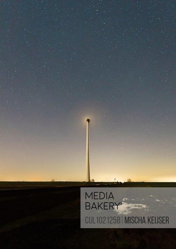 Wind turbines in the polder beside Eemshaven harbour and industrial area, Delfzijl, Groningen, Netherlands
