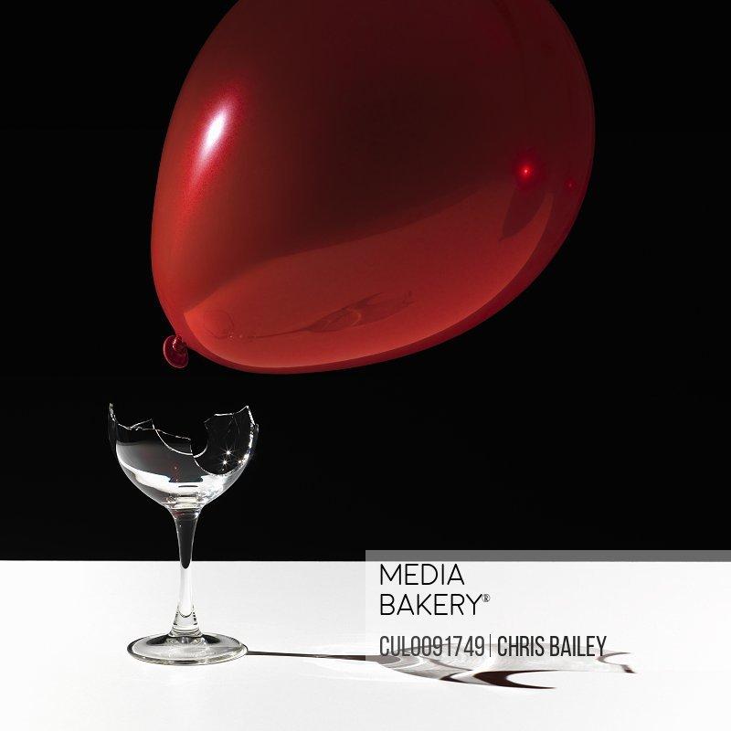 Balloon hovering over broken glass