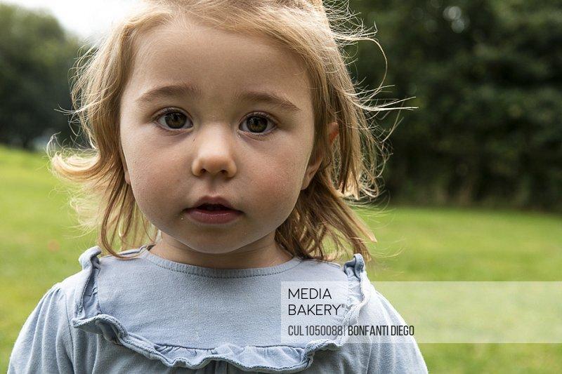 Portrait of little girl in a field