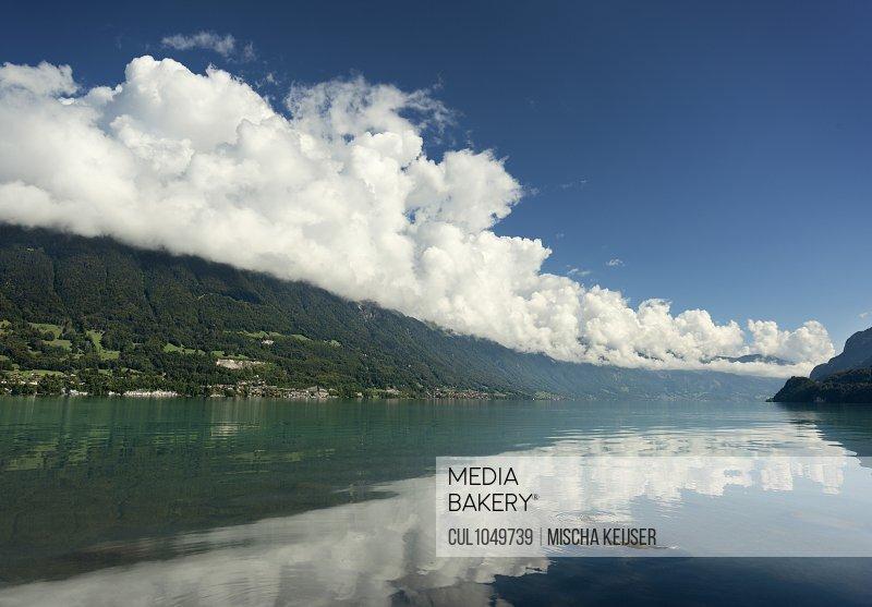 Clouds constantly being formed around the mountain tops surrounding Lake Brienz (Brienzersee), Bonigen, Bern, Switzerland