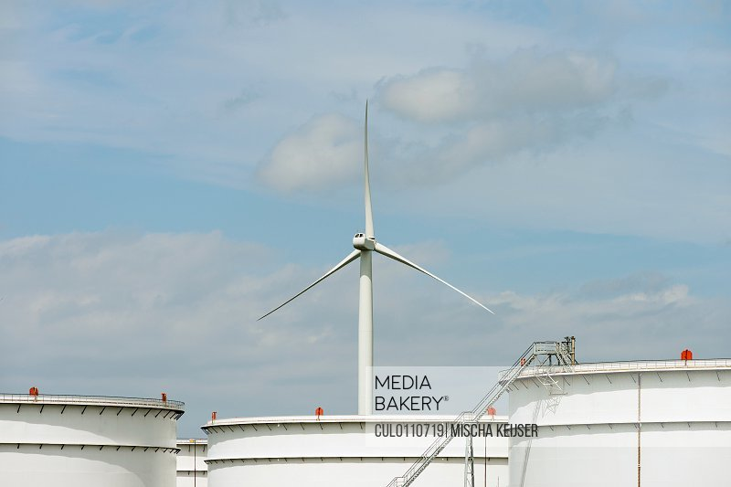 Oil storage and wind turbine in Rotterdam Harbour Holland